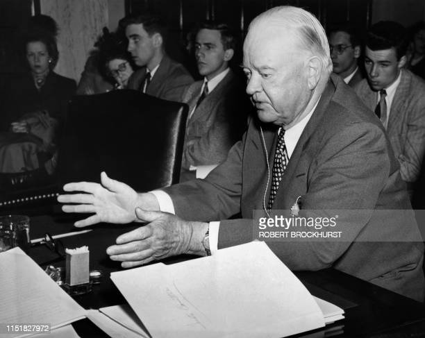 Picture taken on April 11, 1949 at Washington showing former American President Herbert Hoover speaking before the Senate commettee on the government...