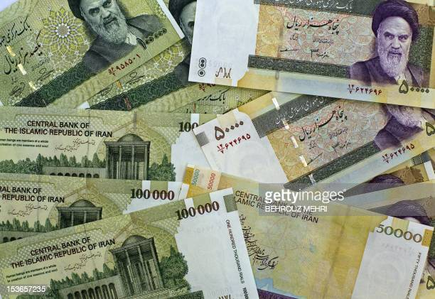 A picture taken on April 11 2011 shows Iran's biggest denomination currencies 100000 Rials and 50000 Rials in Tehran Iran plans to slash four zeroes...