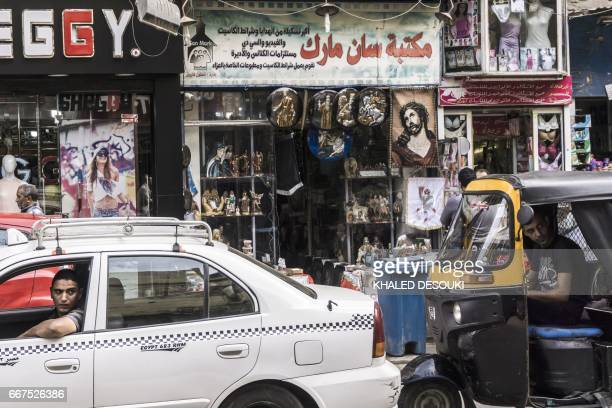 A picture taken on April 11 2017 shows a view outside a church's paraphernalia shop displaying crucifixes and images of Christ and Coptic Orthodox...