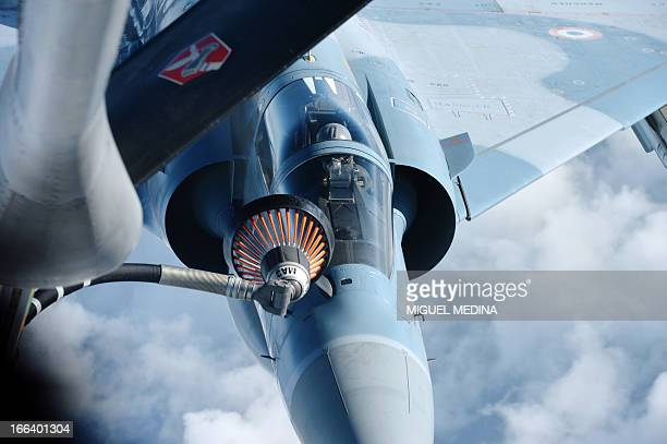 A picture taken on April 12 2013 from a refueling tanker shows a Rafale military aircraft flying over the Avord Air Base central France AFP PHOTO /...