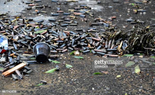 A picture taken on April 12 2017 shows spent bullet casings lying on the ground at Ain alHilweh camp Lebanon's largest Palestinian refugee camp near...