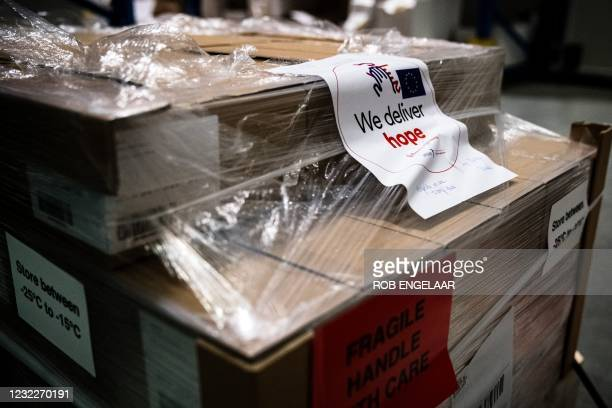 Picture taken on April 12, 2021 shows the first doses of Johnson & Johnson Janssen Covid-19 vaccine proceeding from the Dutch city of Leiden stored...