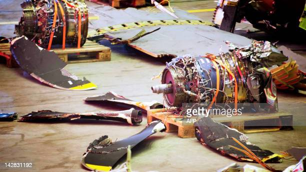Picture taken on April 13, 2012 shows parts of the crashed Norwegian C-130J Hercules plane during a press conference with the Swedish Accident...