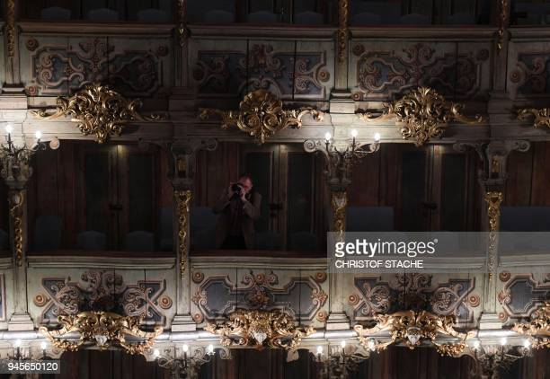 A picture taken on April 13 2018 shows a photographer taking pictures from the spectator boxes at the Margravial Opera House in Bayreuth a day after...