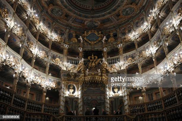 A picture taken on April 13 2018 shows a view of spectator boxes and the painted ceilings at the Margravial Opera House in Bayreuth a day after its...