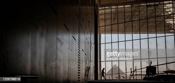 A picture taken on April 13 shows a view of the Great pyramid of Khafre seen through the scaffolding on the Grand Egyptian Museum which is currently...