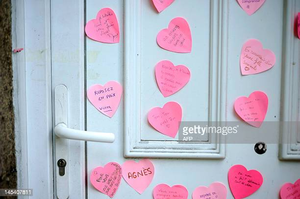 A picture taken on April 14 2012 in Nantes western France shows messages stuck on the door of the Dupont de Ligonnes family's house as part of a...