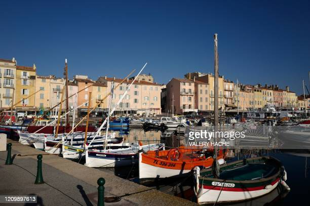A picture taken on April 14 2020 shows the deserted area of the harbour of SaintTropez southeastern France on the 29th day of a strict lockdown aimed...