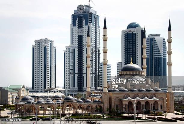 A picture taken on April 14 shows the high rises of the new skyscraper complex GroznyCity dominating the skyline behind Akhmad Kadyrov Mosque known...