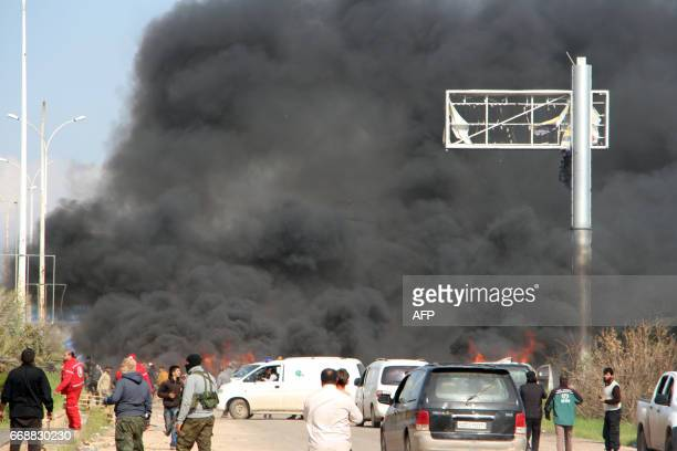 A picture taken on April 15 shows smoke billowing following a suicide car bombing in Rashidin west of Aleppo that targeted buses carrying Syrians...