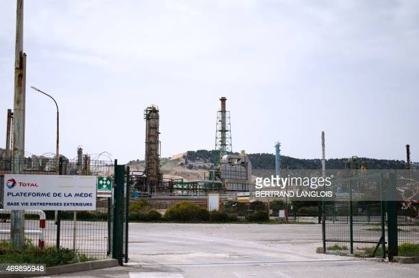 A picture taken on April 16 2015 shows a view of French oil giant Total's La Mede refinery in ChateauneuflesMartigues southern France Total will cut...