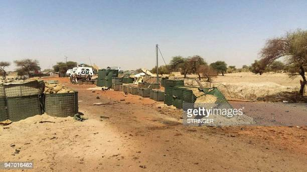 A picture taken on April 16 2018 shows the damages at the entrance of the International troops' 'Super Camp' neighbouring Timbuktu's airport...