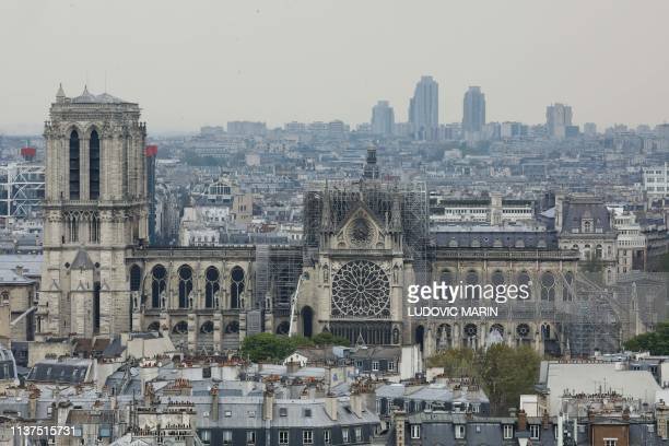 TOPSHOT A picture taken on April 16 2019 shows a general view of NotreDame Cathedral seen from the Pantheon in Paris in the aftermath of a fire that...