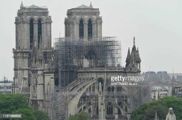 A picture taken on April 16 2019 shows the scaffold on the roof of NotreDamedeParis in the aftermath of a fire that devastated the cathedral Paris...