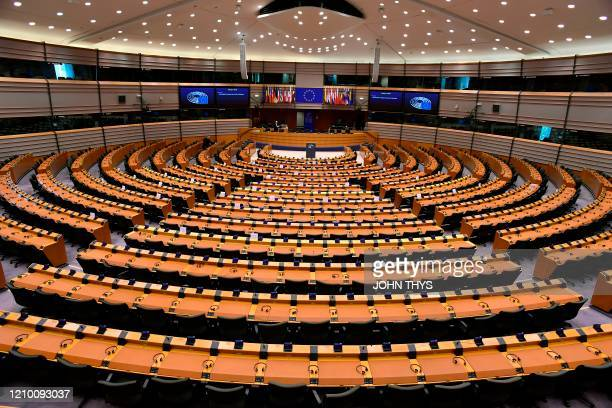 Picture taken on April 16, 2020 shows a view of the almost empty European Parliament in Brussels before a mini plenary session amid the spread of the...