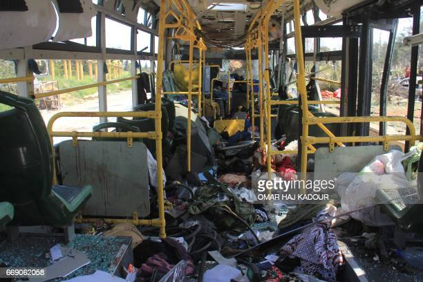 A picture taken on April 16 shows the damage inside a bus a day after a suicide car bombing attack in Rashidin west of Aleppo targeted busses...