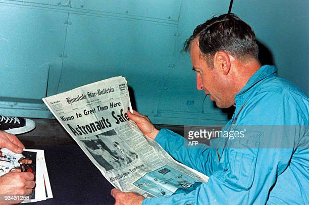 A NASA picture taken on April 17 1970 shows US Apollo 13 mission recued astronaut Jim Lovell aboard USS Iwo Jima reading a newspaper about the crew's...