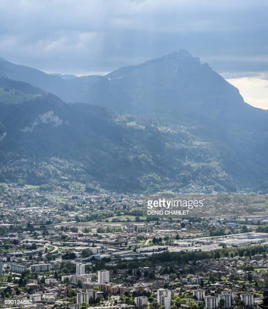 A picture taken on April 17 2017 from Thyez shows a view of the Vallee de l'Arve crossed by the Blanche motorway leading to the Mont Blanc Tunnel The...