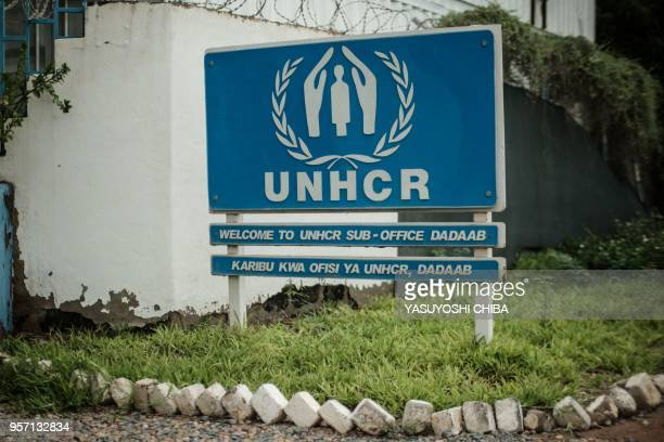 Picture taken on April 17, 2018 shows a signboard of the UN High Commissioner for Refugees at the entrance of the offices at Dadaab refugee complex,...