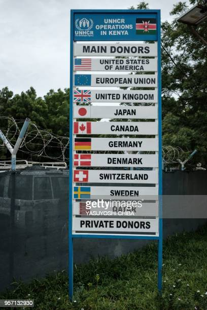 Picture taken on April 17, 2018 shows the names of donor countries on a signboard next to the entrance of the UN High Commissioner for Refugees...