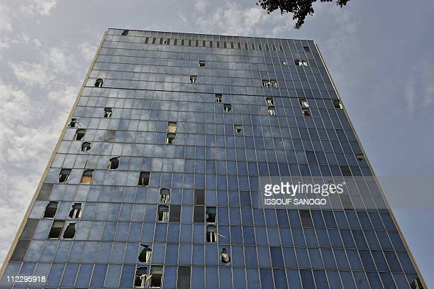 A picture taken on April 18 2011 shows broken windows on a building following the clashes between the rival presidents' forces ahead of Gbagbo's...