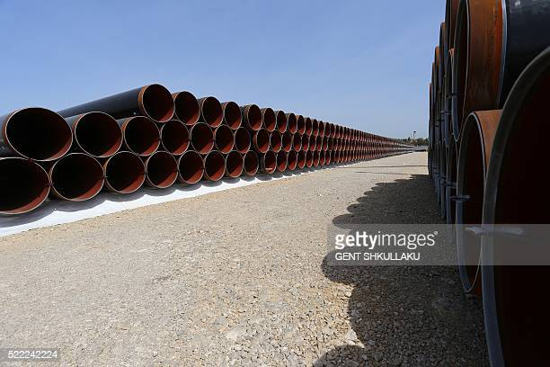 Picture taken on April 18, 2016 shows newly arrived pipes for the future Trans-Adriatic Pipeline in Spitalle, near Durres, aimed to bring gas from...