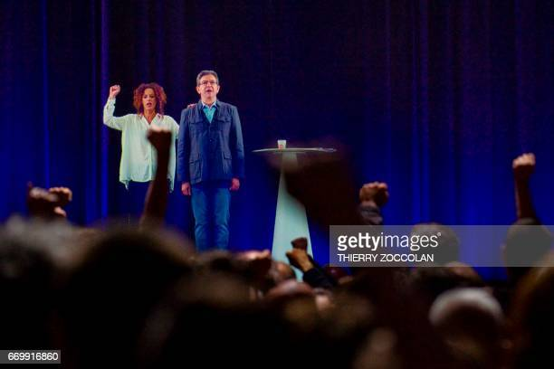 A picture taken on April 18 2017 in Cournond'Auvergne on the outskirts of ClermontFerrand shows an hologram of French presidential election candidate...