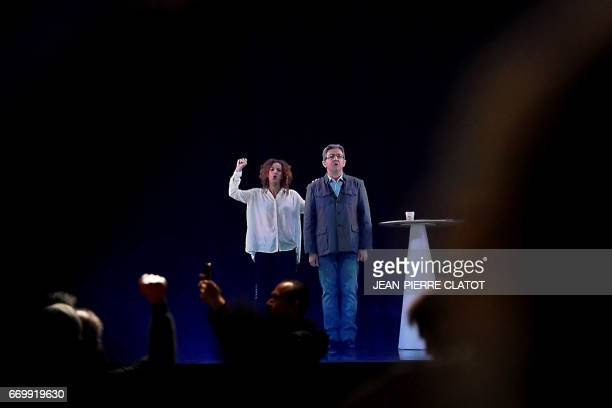 A picture taken on April 18 2017 in Grenoble shows an hologram of French presidential election candidate for the farleft coalition La France...