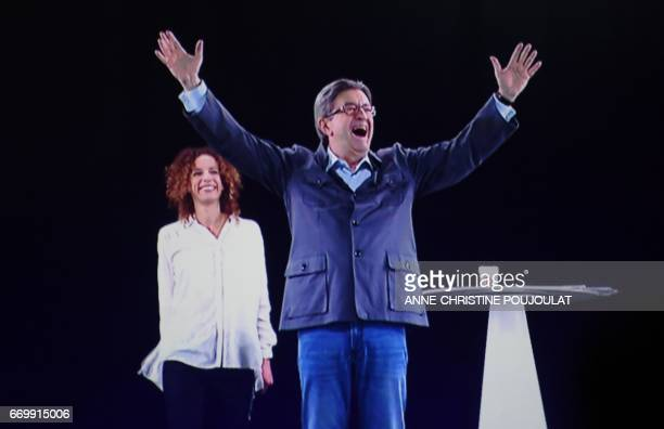 A picture taken on April 18 2017 in Montpellier shows an hologram of French presidential election candidate for the farleft coalition La France...