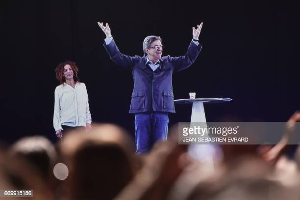 A picture taken on April 18 2017 in Nantes shows an hologram of French presidential election candidate for the farleft coalition La France insoumise...