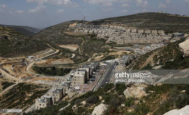 A picture taken on April 19 2019 shows construction works underway in the Israeli settlement of Givat Zeev near the occupied West Bank city of...