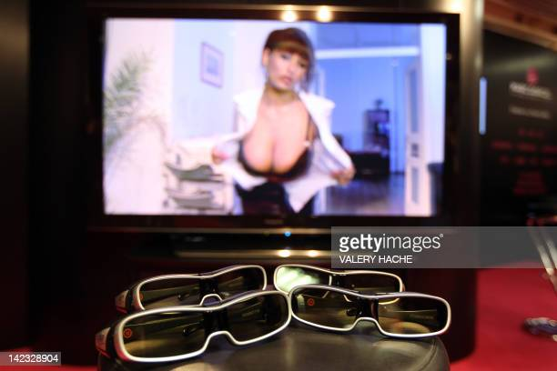 A picture taken on April 2 2012 at the Palais des Festivals in Cannes on the French Riviera shows 3D glasses in front of a screen at the Marc Dorcel...