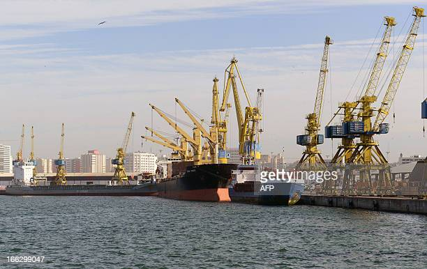 A picture taken on April 2 2013 shows cranes near ships moored at the harbour of the Moroccan economic capital Casablanca The port of Casablanca...