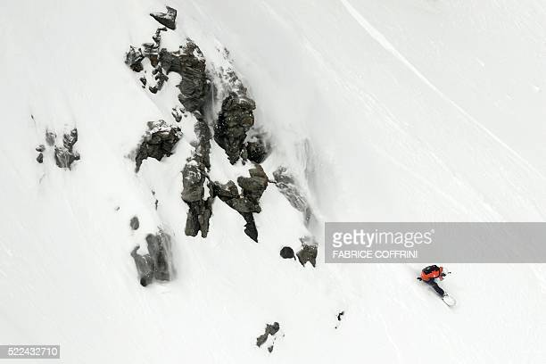 A picture taken on April 2 2016 shows Switzerland's twotime world extreme snowboard champion Estelle Balet competing at the Bec des Rosses during the...
