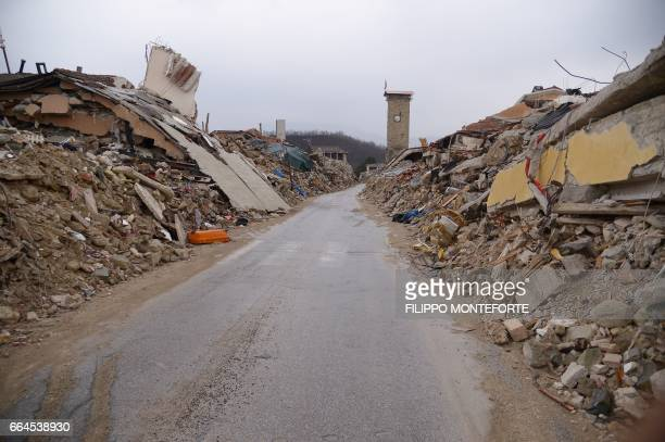 Picture taken on April 2, 2017 shows collapsed buildings in the historic center of Amatrice eight months after a 6.0 quake completely destroyed the...
