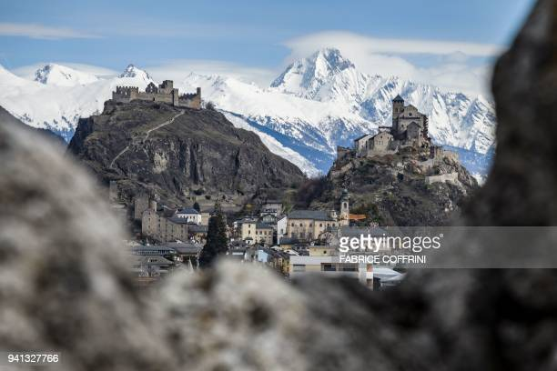 TOPSHOT A picture taken on April 2 2018 in Sion western Switzerland shows Tourbillon Castle and Valere Basilica fortified church overlooking the city...
