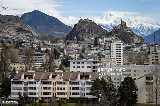Picture taken on April 2, 2018 in Sion, western Switzerland, shows Tourbillon Castle and Valere Basilica fortified church , overlooking the city. The...