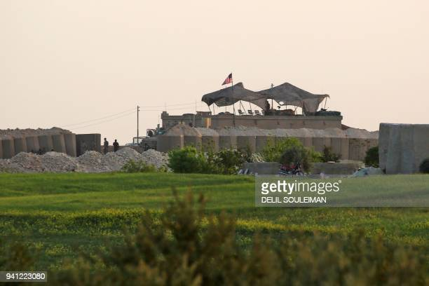 A picture taken on April 2 2018 shows a general view of a US military base in the Dadat village north of the Syrian town of Manbij The Syrian...