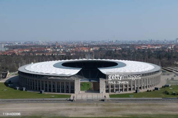 Picture taken on April 2, 2019 in Berlin shows a view of the Olympic Stadium, or Olympiastadion, that was built by Werner March for the 1936 Summer...