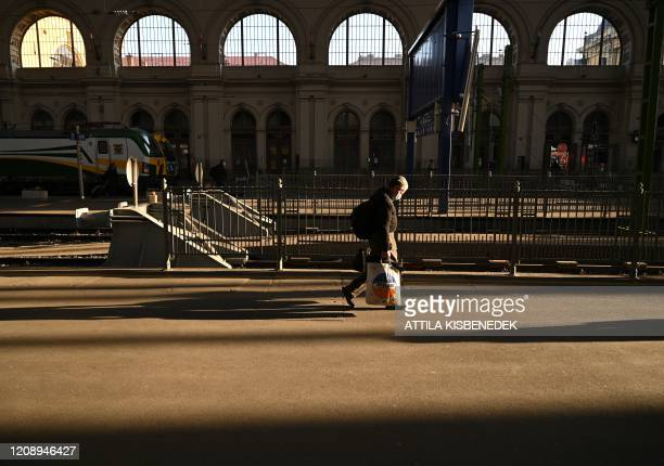 Picture taken on April 2 2020 shows a passenger wearing a protective face mask in Keleti railway station in Budapest Hungary Hungary on April 2 2020...