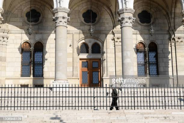 Picture taken on April 2 2020 shows a soldier patrolling in front of the parliament building on the banks of Danube River in Budapest Hungary Hungary...