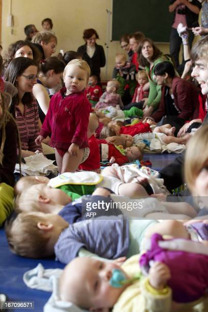 A picture taken on April 20 2013 shows the 'Great Cloth Diaper Change' world record attempt in Gent The event is held simultaneously in 15 countries...