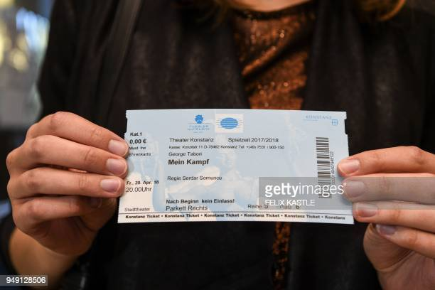 Picture taken on April 20 2018 shows a woman holding a ticket to the play Mein Kampf written by George Tabori and staged by himself at the theatre in...