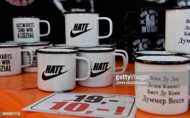 "Picture taken on April 20, 2018 shows far-right paraphernalia displayed for sale at the ""Schild und Schwert"" neo-Nazi festival, in the small eastern..."