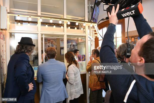 Picture taken on April 20 2018 shows people getting tickets at the theatre where the play Mein Kampf written by George Tabori is been shown in...