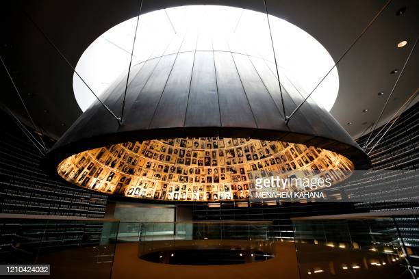 Picture taken on April 20 shows a view of the cieling in the Hall of Names, bearing names and pictures of Jewish Holocaust victims, at the Yad Vashem...