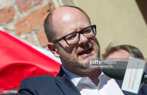 Picture taken on April 21 2018 shows the Mayor of Gdansk Pawel Adamowicz as he gives a speech in front of people taking part in an antifascist...