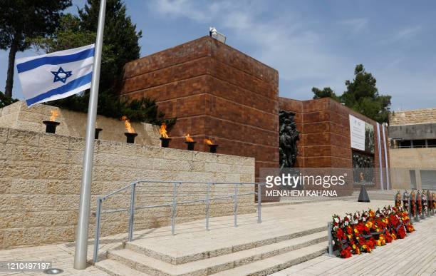 Picture taken on April 21, 2020 shows six torches in memory of Jewish Holocaust victims during a ceremony without participants due to the COVID-19...