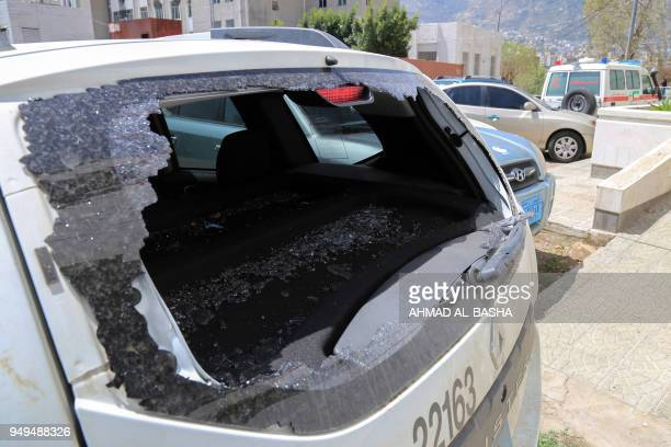 Picture taken on April 21 shows the shattered rear window of the Red Cross vehicle that was carrying Red Cross employee Hanna Lahoud, parked outside...