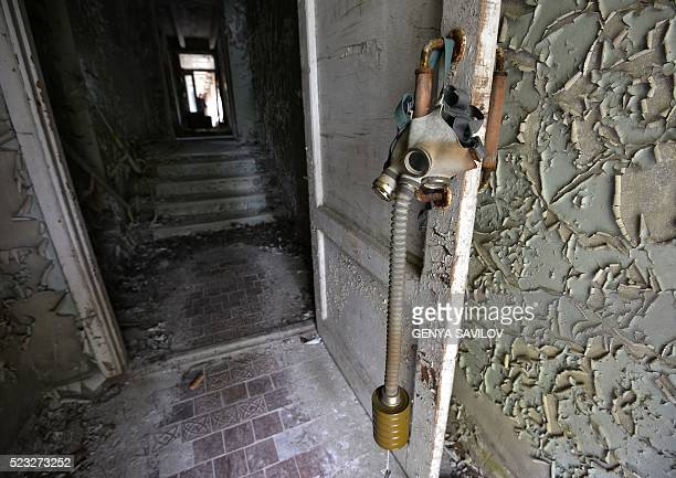 A picture taken on April 22 2016 shows a gas mask in an abandoned building in the 'ghost town' of Pripyat near the Chernobyl Nuclear Power Plant...